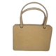 Bolso de mano de piel en tono crema . Leather handbag in cream