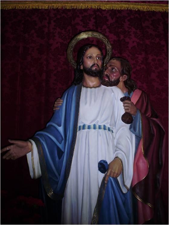 Jesús recibe el beso de Judas traicionado por una bolsa de monedas. Iglesia de Ayamonte